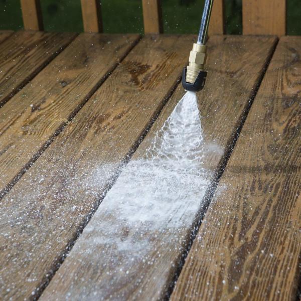 spraying wooden floor